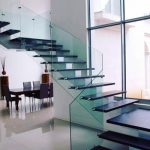 Dramatic stairway combining glass and wood